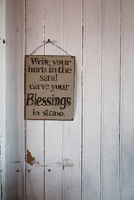 Inspirational Board On White Wooden Wall