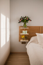 Bouquet Of Tulips And Decoration Close To Bed In A Bright And Sunny Room