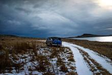 Blue Van Parked Near Snowy Road