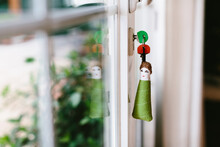 Soft Fabric Key Chain With Keys Sticking Out From Keyhole Of Terrace Door