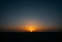 Sunset Sky Over Arid Desert