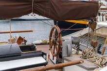 Wooden Helm In The Deck Of A Vintage Vessel