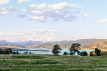 View Of Paddocks And Lake St Clair In The Distance In Evening Light