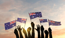 Silhouette Of Arms Raised Waving An Australia Flag With Pride. 3D Rendering