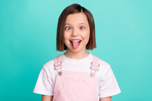 Photo Of Funky Happy Cheerful Young Little Girl Make Funny Face Good Mood Isolated On Teal Color Background