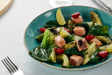 Salmon And Avocado Fillet Salad With Artichokes, Fried Salmon Cubes In Sauce With Grilled Vegetables, Avocado And Artichokes, Light Background, Close-up.