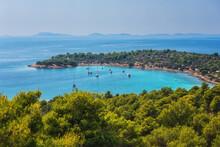 Amazing Seascape, Scenic Panoramic View Of The Kosirina Beach, Fantastic Turquoise Adriatic Sea, Green Trees And Blue Sky, Murter Island, Dalmatia, Croatia. Outdoor Travel Background
