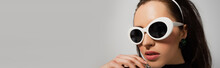 Young Woman In White Retro Sunglasses Isolated On Grey, Banner.