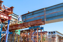 Close-up View Of Road Bridge Under Construction. Connection Of Steel Powerful Straight Crossbar, Bridge Connection, Metal Architecture