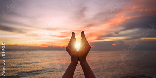 Canvastavla June summer solstice sun concept with silhouette of happy young woman's hands re