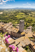 The Medieval City Of San Gimignano, Tuscany, Italy, Shot From Above With Tuscacn Landscape In The Background