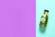 Leinwandbild Motiv Bottle with cucumber lemonade on color background