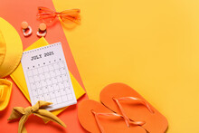 Calendar, Notebook And Beach Accessories On Color Background