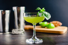 Thai Basil Gimlet Cocktail With Garnish: A Gin Cocktail In A Coupe Glass