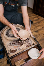 Person Molding Clay Mass Behind Pottery Wheel