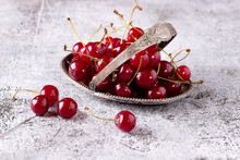 Ripe Cherry Berries In A Vintage Metal Plate.