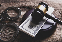 Judge's Hammer, Money And Handcuffs On The Table