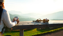 Woman Drinking Coffee In Sun Sitting Outdoor In Sunshine Light Enjoying Her Morning Coffee, Vintage. Lifestyle Concept