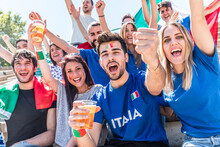 Italian Supporters Celebrating At Stadium With Flags