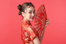 Asian Chinese Woman In Traditional Dress On Red Background. Chinese New Year Festival.
