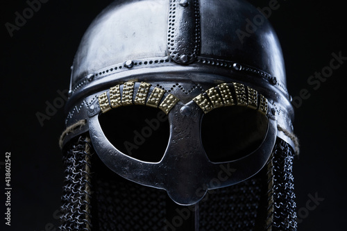 Fotografia Studio shot of iron helmet against dark background