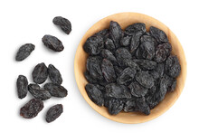 Black Raisin Iin Wooden Bowl Solated On White Background With Clipping Path. Top View. Flat Lay