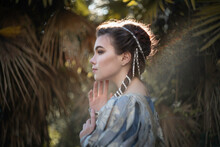 Aristocratic Woman In The Rays Of The Sun In A Tropical Garden