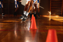Diverse Male Basketball Team Wearing Blue Sportswear And Practice Dribbling Ball