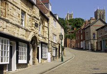 Historic Buildings In Steep Hill Lincoln, With The Towers Of Lincoln Cathedral Towering Over Head, City Of Lincoln, Lincolnshire, England, UK