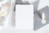 Wedding invitation card mockup, grey envelopes, rings on white background. Flat lay, top view. Minimal style.