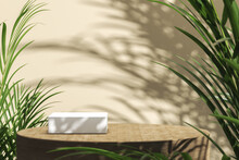 The White Platform Top On Wooden Cylindrical On Beige Background, Blur Tropical Plants Foreground And Shade On Background, Abstract Background For Product Presentation. 3d Rendering