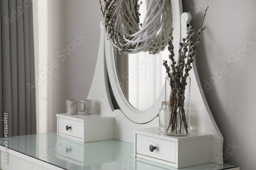 Fototapeta Elegant dressing table decorated with pussy willow branches indoors