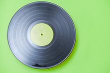 Old Vinyl Record On Green Background