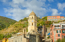 The Santa Margherita Di Antiochia Church With It's Bell Tower And Clock At The Village Of Vernazza, Cinque Terre Italy