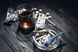 Alcohol, drugs and cigarettes on table. Concept of addiction