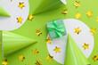 Leinwandbild Motiv Gift box with party hats and confetti on color background