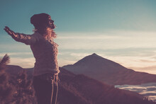 Happy Free Woman Open Arms And Enjoy The Amazing Beautiful Sunset At The Mountain - Active People And Outdoor Leisure Activity - Hiker Female Adult And Landscape View In Background