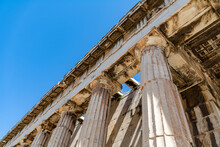 Low Angle View Of The Portico With Ancient Columns At The Temple Of Hephaestus, Located In The Agora Of Athens
