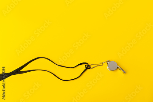 Tela Sports whistle on yellow background