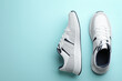 canvas print picture - Pair of stylish sports shoes on turquoise background, flat lay. Space for text