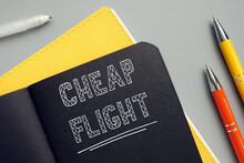 Business Concept Meaning CHEAP FLIGHT With Sign On The Piece Of Paper. Cheapflights Is A Travel Fare Metasearch Engine.