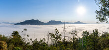 Beautiful Panorama Landscape Of Sea Mist On Phu Thok Forest Hill View Point With Blue Sky And Bright Sun, Travel Attraction In Chiang Khan District, Loei, Thailand