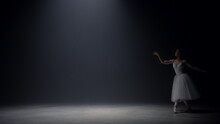Sensual Ballerina Jumping On Stage. Ballet Dancer Dancing Pointe Shoes Indoors.