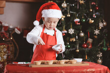 Young Girl Preparing Mince Pie For Celebrating  Christmas Party