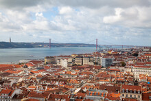 Lisbon Bridge And View Of Red Tiled Roofs