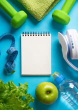 Fitness Concept Background. Top View Of Things For Exercise And Sports And Diet.