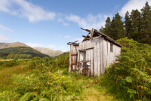 Abandoned Shed In The Scottish Highlands With A Broken Rusted Bike Outside  - UK