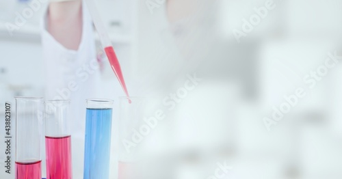 Composition of scientist holding pipette in laboratory with copy space