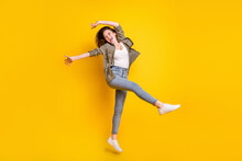 Full Length Photo Of Sweet Pretty Young Lady Wear Brown Shirt Jumping Dancing Isolated Yellow Color Background