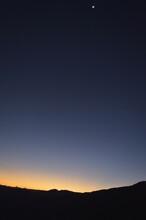 Orange Sunrise With The Moon